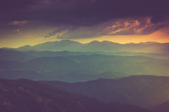 Landscape of misty mountain hills in spring. Royalty Free Stock Photo