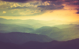 Landscape of misty mountain hills in spring. Stock Photos
