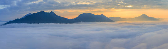 Landscape misty panorama. Fantastic dreamy sunrise on the mounta. Ins with a beautiful view. Foggy clouds above the landscape Royalty Free Stock Image