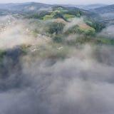 Landscape misty panorama. Fantastic dreamy sunrise on rocky moun Royalty Free Stock Image