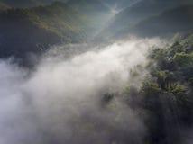 Landscape misty panorama. Fantastic dreamy sunrise on rocky moun Royalty Free Stock Photo