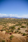 Landscape in Moab, Utah. Dry, rugged landscape in Moab, Utah, with mountains in distance Royalty Free Stock Photo