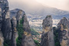 Landscape of monasteries of Meteora in Greece in Thessaly at the early morning. Cliffs of Meteora opposite a morning cloudy sky ba Stock Image