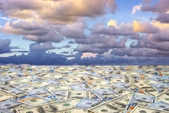 Landscape with money. Conceptual abstract landscape: sea of money and dramatic sky stock photography
