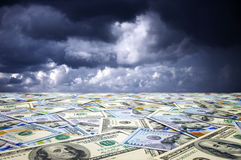 Landscape with money. Conceptual abstract landscape: sea of money and dramatic sky stock photo