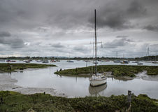 Landscape of moody evening sky over low tide marine Stock Images