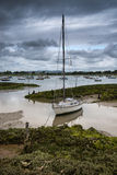 Landscape of moody evening sky over low tide marine. Of yachts Royalty Free Stock Image