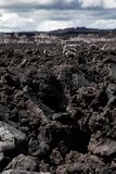 Landscape Mordor. Gloomy lava field reminiscent of the scene Mordor in Middle Earth royalty free stock images