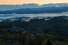 Landscape with a morning fog and vineyards Stock Photo