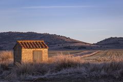 Landscape in the morning light with an old barn. Near the Gallocanta Lake in Spain.  The Gallocanta Lake Spanish: Laguna de Gallocanta is an endorheic lake Royalty Free Stock Photography