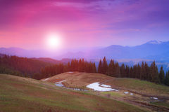Landscape of morning twilight in the spring mountains. Stock Photos