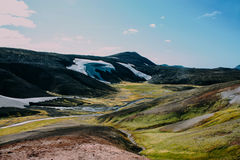 Landscape with moss and snow in Iceland. Mountain tourism Stock Image