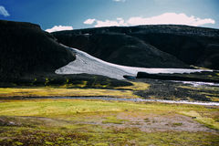 Landscape with moss and snow in Iceland. Mountain tourism Stock Images