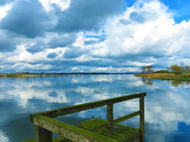 Landscape with mossy jetty Stock Photos