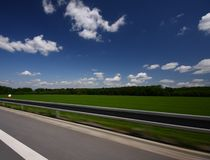 Landscape in motion. Landscape from a fast car Royalty Free Stock Photography