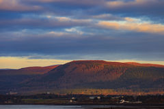Landscape of mountain at Cromarty Firth during Sunset in Invergordon Royalty Free Stock Images