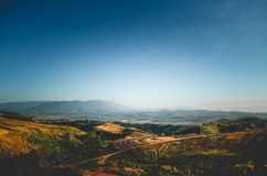 Landscape Mountain Dramatic sky yellow field. Beautiful Royalty Free Stock Images