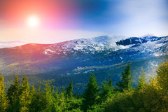 Landscape in the mountain:hazy tops and autumn valleys. Fantastic evening glowing by sunlight Royalty Free Stock Photography