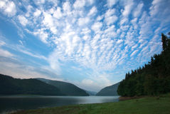 Landscape mountain lake against the blue sky Royalty Free Stock Photos