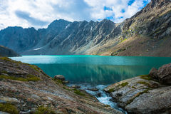 Landscape with mountain lake Ala-Kul, Kyrgyzstan. Royalty Free Stock Image