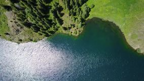 Landscape mountain lake in the forest. Shooting with the drone.