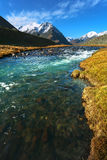 Landscape of mountain peaks and swift rivers in the fall. Royalty Free Stock Photo