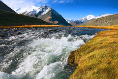 Landscape of mountain peaks and swift rivers in the fall Royalty Free Stock Photography