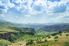 Landscape of the mountain plain, green hills and vineyard, Armenia. Travel Stock Images