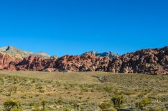 Mountain Range in the Desert. Landscape of the mountain range in the desert. Red Rocks and desert brush Stock Images