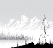 Landscape with mountains near lake Stock Images