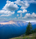 Landscape mountain ridge on a background of blue sky Stock Images