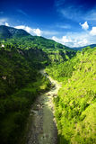 Landscape with mountain river and blue sky Royalty Free Stock Photo
