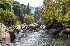 Landscape of the mountain river Mandovi at the Dudhsagar waterfall royalty free stock photography