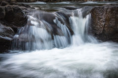 Landscape of mountain river in sunshine. View of the stony rapids. Stock Images