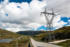 Landscape with mountain road and high voltage reliance line, Norway Stock Photo