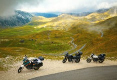 Landscape with mountain road and three motorbikes Royalty Free Stock Images