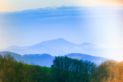 Landscape in the mountain:snowy tops and green valleys. Stock Photography