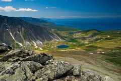 Landscape from the mountain top. View of lakes, alpine meadows and the open sea from the mountain top Stock Images