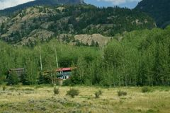 Landscape from a mountain trail of a ranch deep in the Rocky`s. stock photo
