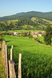 Landscape with a mountain village. Clear blue sky and wood fence at the country side royalty free stock photos