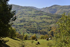 Landscape with mountain village at the beginning of autumn. Royalty Free Stock Photos