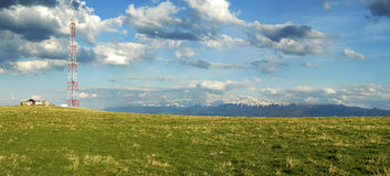 Landscape with mountains. Panorama landscape with communication antenna, mountains and beautiful sky in transylvania, romania stock image