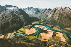 Landscape Mountains aerial view fields valley and blue river in Norway Stock Images