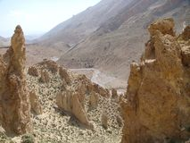 Landscape of the mountains of the Atlas in Maroc with the traces of a river and rocks formed by geological modifications. Stock Photos