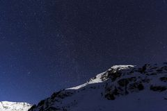 Landscape with mountains and blue sky in winter night Royalty Free Stock Photos