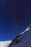 Landscape with mountains and blue sky in winter night Royalty Free Stock Image
