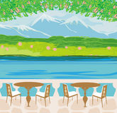 Landscape with mountains and cafe tables Royalty Free Stock Image