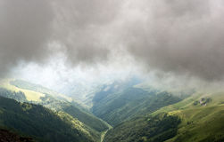 Landscape in mountains with clouds and fog. More stock image