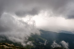 Landscape in mountains with clouds and fog. More available stock images