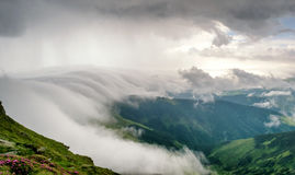 Landscape in mountains with clouds and fog. More available royalty free stock image